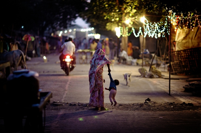 A woman is lifting her child on the streets of Oriya Basti, one of the nineteen water-affected colonies surrounding the abandoned Union Carbide (now DOW Chemical) industrial complex in Bhopal, Madhya Pradesh, India.