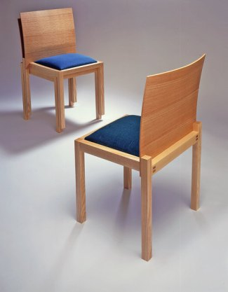 Named after Ben's son, these compact and comfy Dominic stacking chairs sport flexible one-piece laminated backs.