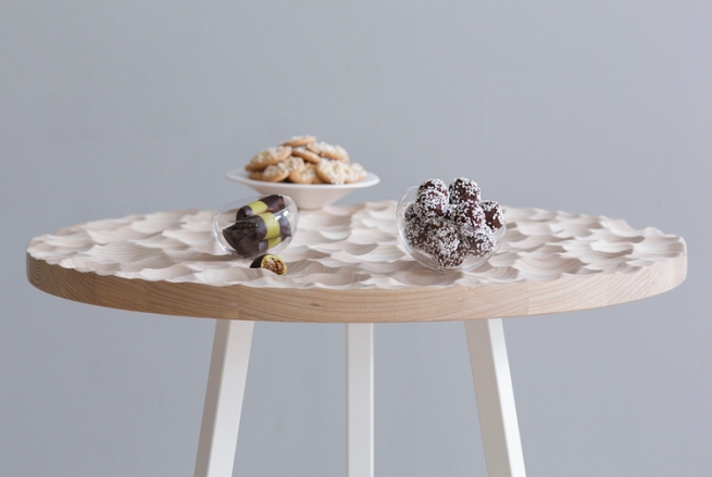 Umami café Table and table top items, 2015 A café table with custom table top items in handmade ceramic and glass, that fit perfectly into the three dimensional structure. Umami café is a development of the project  Umami .  The table top items for Umami café are the same as for Umami.  Material: ash, steel, hand blown glass and ceramics Table: Ø 700 mm, h 720 mm Glass bowl, small: Ø 90 mm, h 60 mm Glass bowl medium: Ø 110 mm, h 70 mm Glass bowl, large: Ø 130 mm, h 85 mm Ceramic serving plate: Ø 195 mm, h 55 mm Photo: Petter Brandt