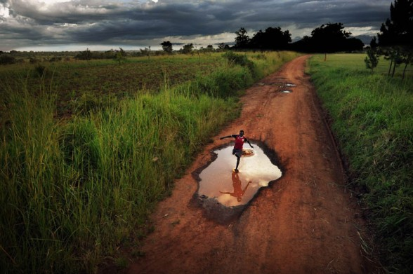 """Gulu, Uganda. Wilberforse, 11 yrs, lives in Northern Uganda together with his parents and 6 brothers and sisters. """"I want to be the fastest. I want my parents, my school and country are proud of me. Every day I run. I dream of coming home with the biggest trophy"""""""